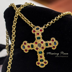 crucifix(0.0), symbol(1.0), jewellery(1.0), chain(1.0), cross(1.0), necklace(1.0), pendant(1.0),