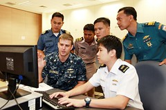 Officers taking part in a previous SEACAT exercise work together in Singapore. (Singapore Ministry of Defence file photo)