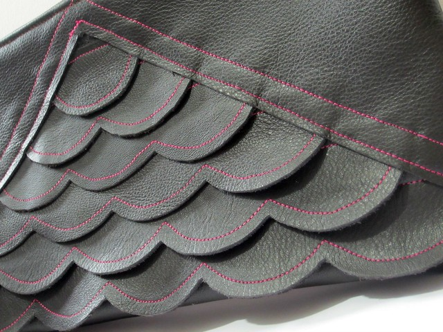 leather scalloped clutch detail