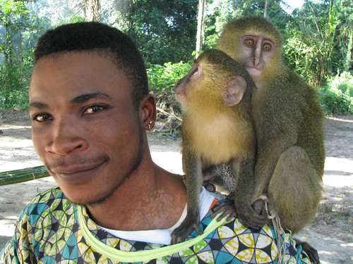 Danny, a bushmeat buyer, with baby lesulas in Obenge