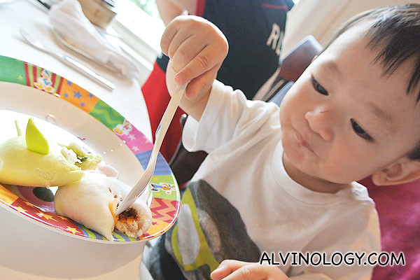 Asher eating with his own cutlery