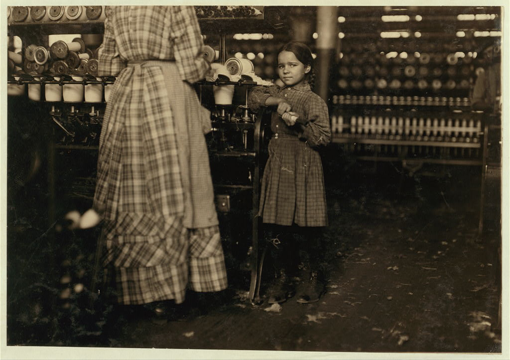 "Little Fannie, 7 years old, 48 inches high, helps sister in Elk Mills. Her sister (in photo) said, ""Yes, she he'ps me right smart. Not all day but all she can. Yes, she started with me at six this mornin'.&quot Location: Fayetteville, Tennessee"