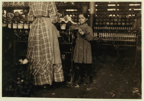 "Little Fannie, 7 years old, 48 inches high, helps sister in Elk Mills. Her sister (in photo) said, ""Yes, she he'ps me right smart. Not all day but all she can. Yes, she started with me at six this mornin'""... (LOC)"