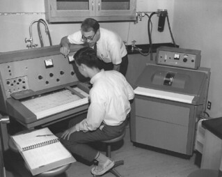 Students working with a Varian NMR in Seaver North in 1965