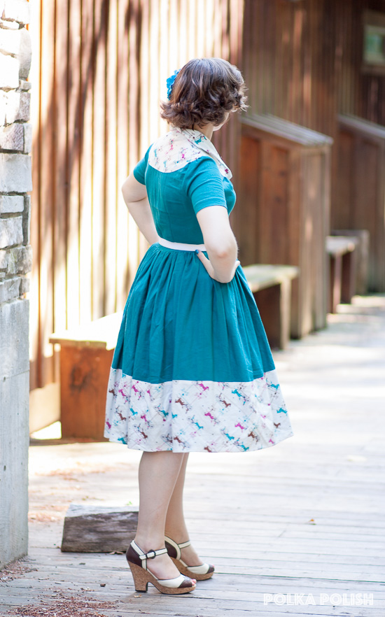 Vintage Butterick 7238 in an aqua linen blend with contrasting novelty print weathervanes in brown, pink, and teal