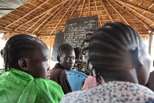 Women in the Republic of South Sudan in Yei near the border with Uganda attending a literacy class. Figures indicate a huge need for education inside the country. by Pan-African News Wire File Photos