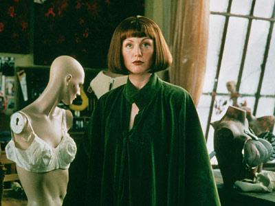 Maude Lebowski in a green cape