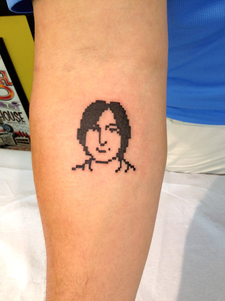 Steve Jobs icon tattoo