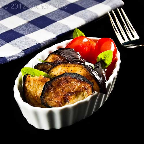 Roast Eggplant in Dish with Grape Tomatoes and Basil
