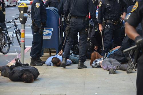 3 #FuckColumbus on ground zip-tied Not #occupysf #oo #ows