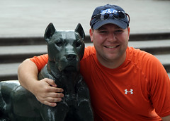Posing with dog statue