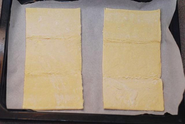 cut pastry sheet in half for Puff pastry pizzas with mushrooms, bell peppers, Mozzarella and Parmesan cheese