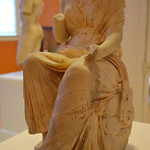 Seated figure of a Muse.