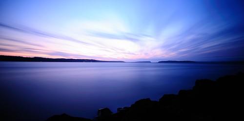 pink blue sunset beach water clouds rocks purple smooth calm shore pugetsound
