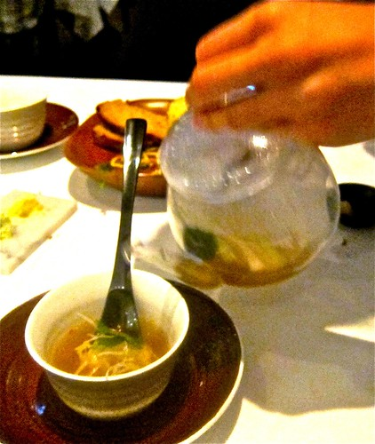 pouring soup on xiao lung pao dumpling