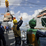 Sailors conduct a replenishment at sea.