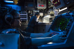 Operations Specialist 3rd Class Bryanna Artellano stands watch in the combat information center aboard USS Harpers Ferry (LSD 49) as the ship transits the South China Sea. (U.S. Navy/MC3 Zachary Eshleman Bryan)