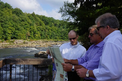 USDA Rural Development Deputy Under Secretary Doug O'Brien (left) and Rural Development State Director Thomas Williams (right) review the Great Allegheny Passage trail map with David Kahley (center) of The Progress Fund. USDA photo by Dawn Bonsell