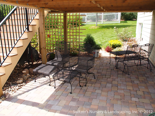 paver patio under deck with retaining wall steps minne
