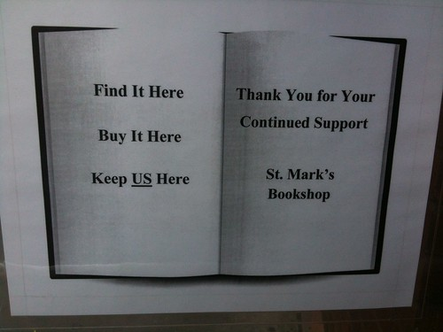 In the front door window, St. Mark's Bookshop