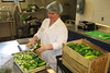 Christy Mendoza, director of the Chilton Food Innovation Center, works with cucumbers in the industrial kitchen designed for local farmers and entrepreneurs.