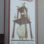 Huge World 100 poster adorning the suites.