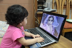 Nerjis Asif Shakir Watches Her First Birthday Video by firoze shakir photographerno1