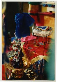 Wrathful torma offering for yidam, silk cover, sand mandala on silver mandala plate, shrine, Sakya Lamdre, 13 Golden Dharmas, Tharlam Monastery of Tibetan Buddhism, Boudha, Kathmandu, Nepal 1990
