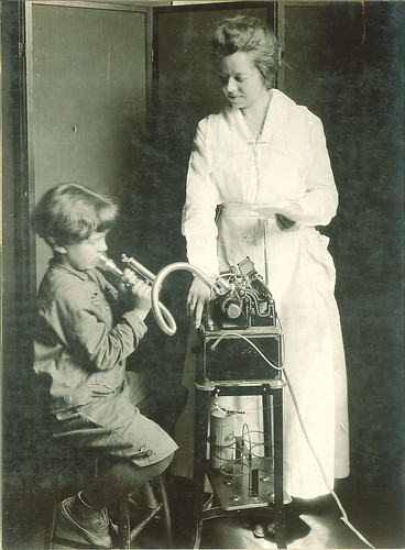 Measuring lung capacity with a spirometer, The University of Iowa, ca. 1920
