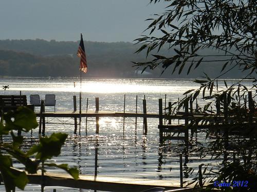 light water sunrise dock flag americanflag oldglory starsstripes chautauqua chautauquainstitution chautauquany chautauqualake blinkagain