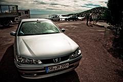 automobile(1.0), automotive exterior(1.0), peugeot(1.0), wheel(1.0), vehicle(1.0), automotive design(1.0), bumper(1.0), land vehicle(1.0), peugeot 406(1.0),