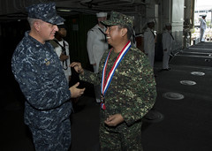 Flag Officer In Command, Philippine Navy Vice Adm. Alexander P. Pama, is welcomed aboard USS Bonhomme Richard Oct. 8 by Commanding Officer Capt. Daniel Dusek. (U.S. Navy photo by Mass Communication Specialist Seaman Lacordrick Wilson)