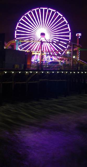 Ferris Wheel lights reflected in ocean waves - Santa Monica Pier, California, USA