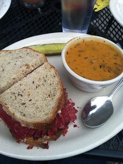 A pastrami sandwich with a side of soup from Kenny & Zukes.