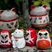 Cats and Daruma Statues at Daisho-In Temple - Miyajima, Japan