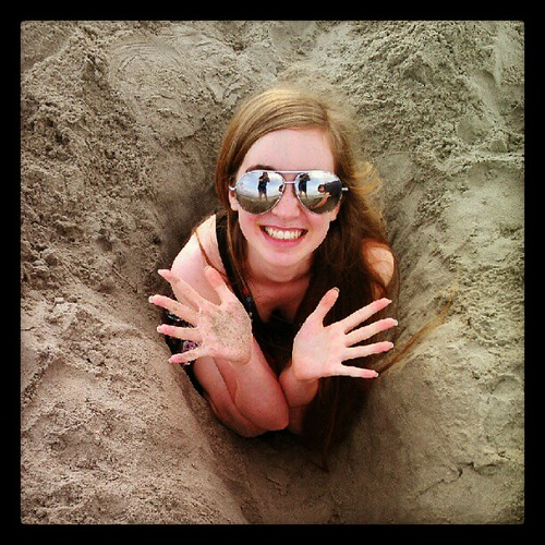 Wow, that's a deep hole! (Okay, she's crouching for dramatic affect.)