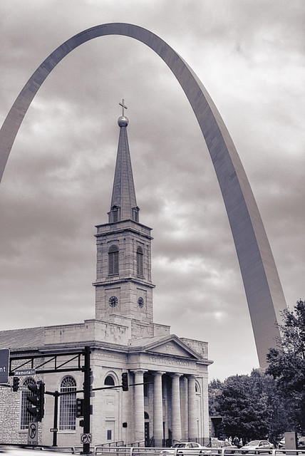 Basilica of Saint Louis, King of France, with Gateway Arch, in Saint Louis, Missouri, USA