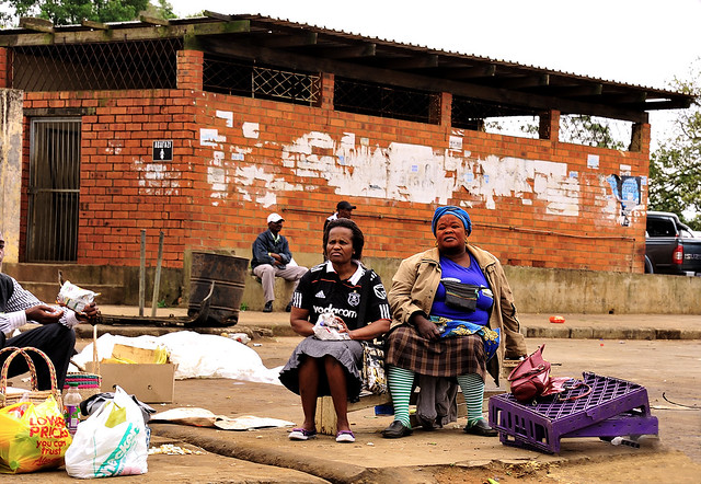 two zulu mamas sitting waiting for a bus with proud. Black Bedroom Furniture Sets. Home Design Ideas