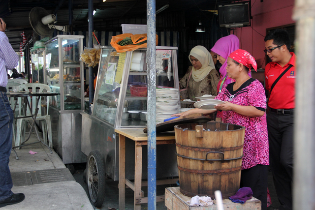 The legendary wooden barrel of fragrant nasi lemak rice