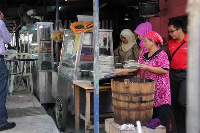 The legendary wooden barrel of fragrant nasi lemak rice