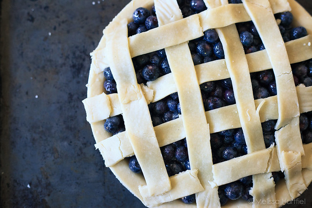 an unbaked blueberry pie with lattice