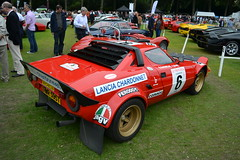 rallying(0.0), ferrari 512(0.0), dirt track racing(0.0), compact car(0.0), race track(0.0), race car(1.0), auto racing(1.0), automobile(1.0), lancia(1.0), racing(1.0), vehicle(1.0), motorsport(1.0), antique car(1.0), land vehicle(1.0), supercar(1.0), sports car(1.0),