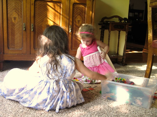 Little Girls Picking Up Toys