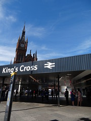King's Cross Station sign With St. Pancras Station in the background