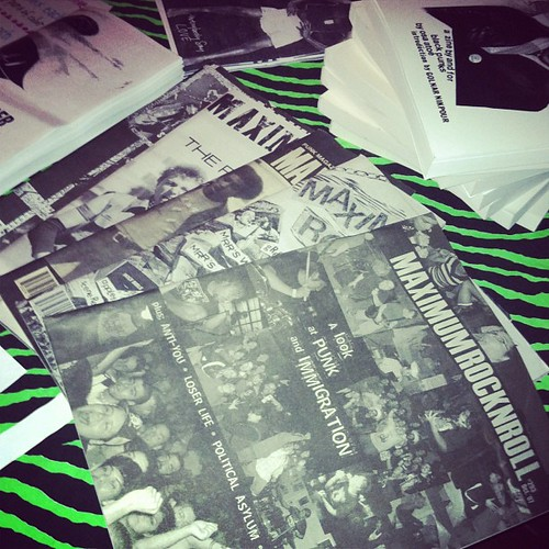 Issues of Maximumrocknroll are part of the merch table on the Race Riot! tour