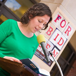 12-045 -- Assistant Professor of Sociology Meghan Burke was among volunteers reading from their favorite banned books during a Banned Books Week Read-Out at The Ames Library.
