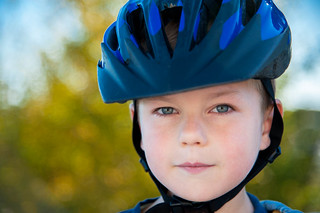 Boy with bicycle helmet