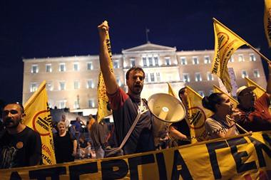 Demonstrations in Greece opposing the imposition of austerity. German Chanceller Angela Merkel visited the country on October 9, 2012. by Pan-African News Wire File Photos