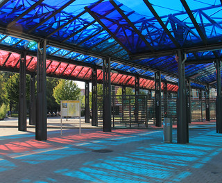 Bus station with colored shadows. On Sunday morning.