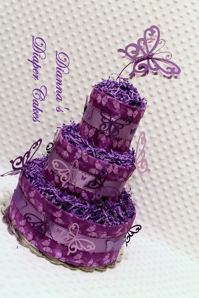 Butterflies in purple baby diaper cake shower centerpiece